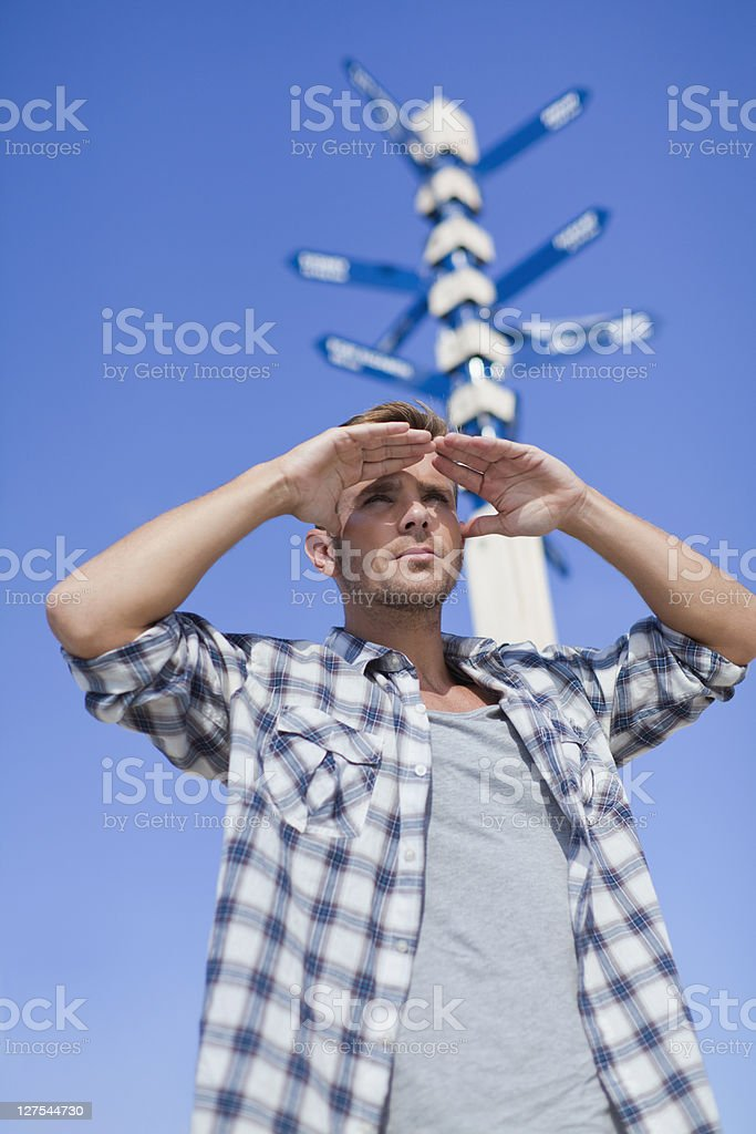 Man admiring view at crossroads stock photo