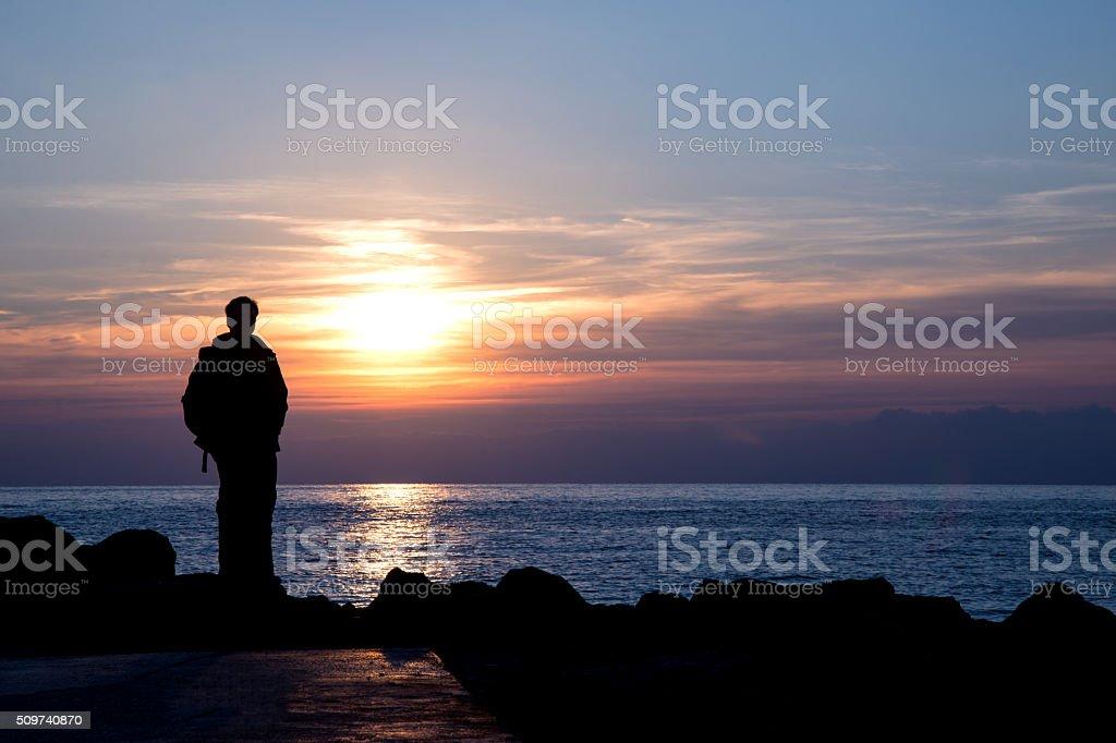 man admiring winter sunset stock photo