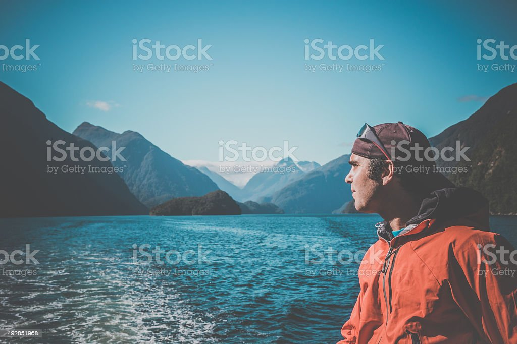 Man Adventurer in Milford Sound, South Island, New Zealand stock photo