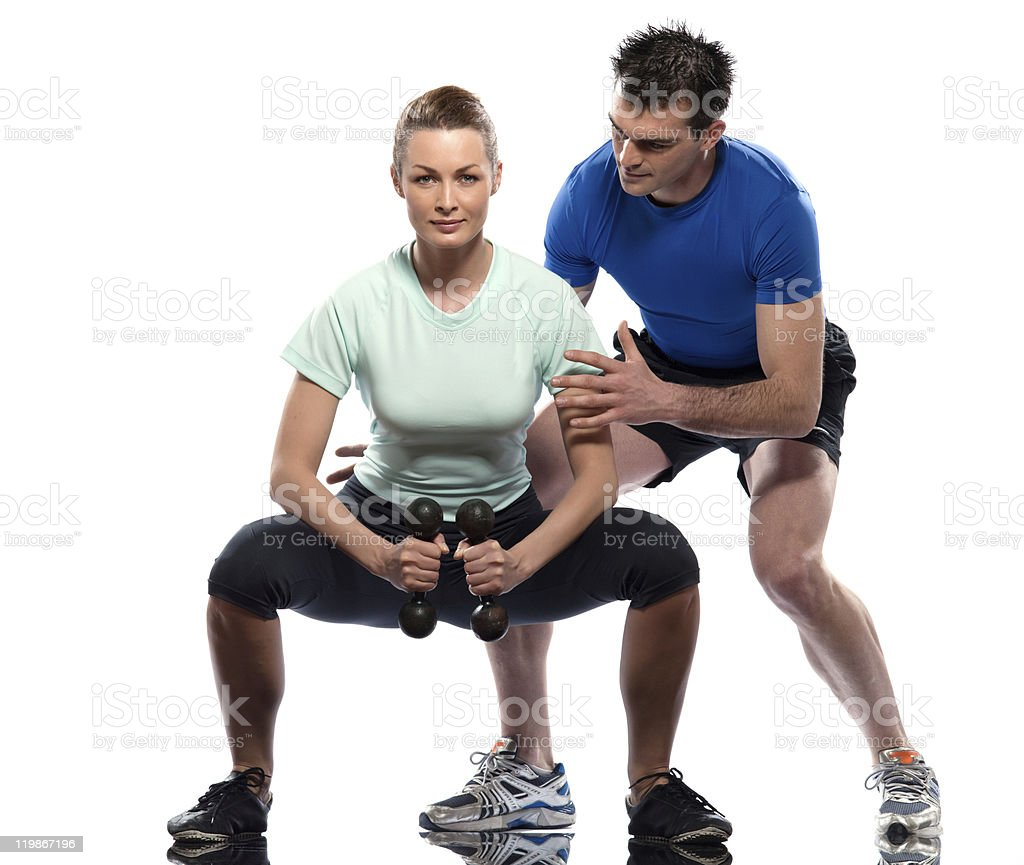 man aerobic trainer positioning woman  Workout Weight Training stock photo