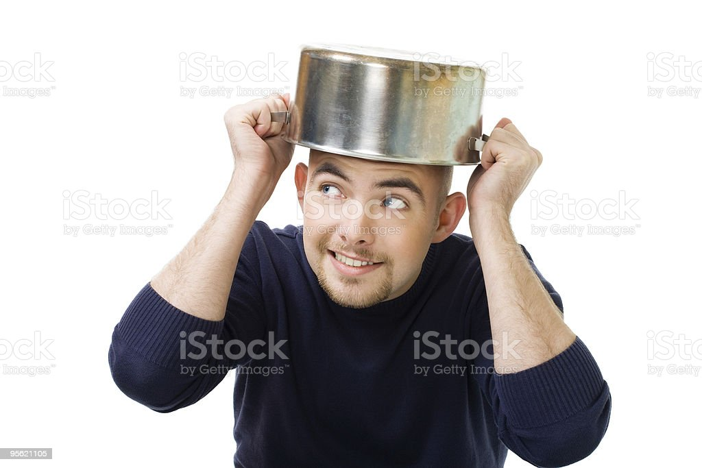 Man afraid and protecting with casserole royalty-free stock photo
