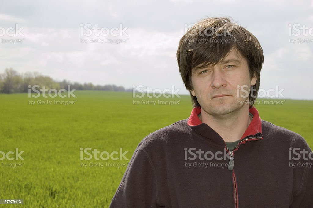 man against spring meadow royalty-free stock photo