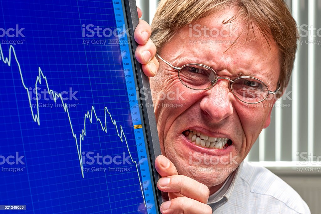 man agry about sinking stock exchange rate stock photo