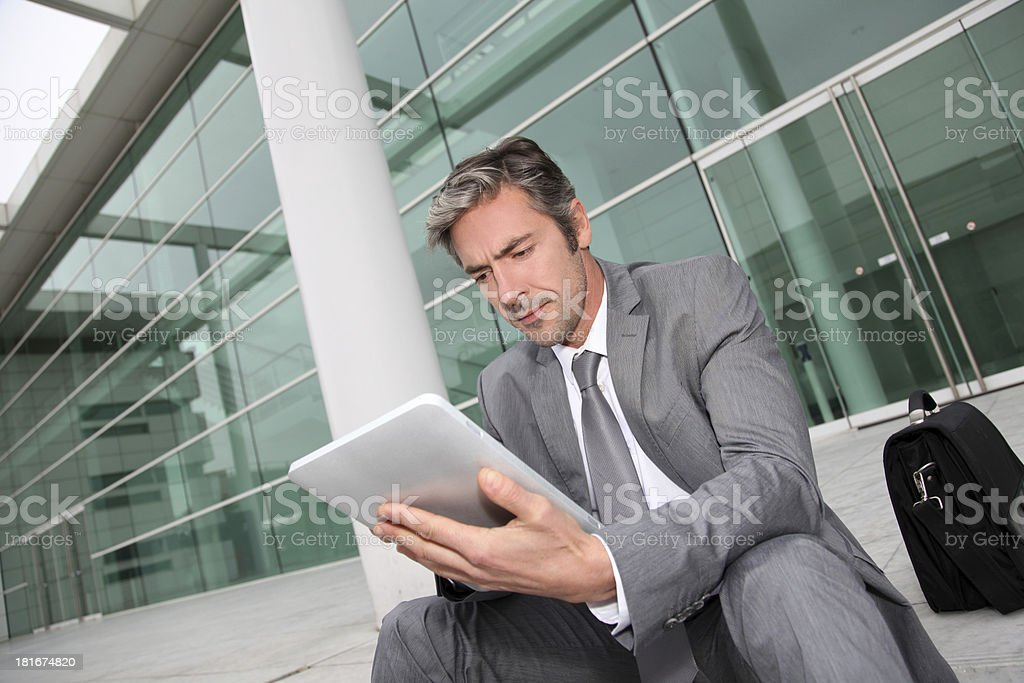 Man ahead to his appointment and waiting on stairs royalty-free stock photo