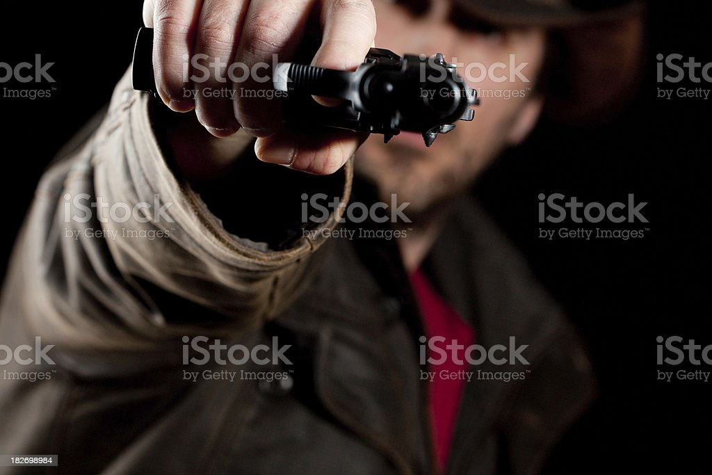 Man aiming a gun at you royalty-free stock photo