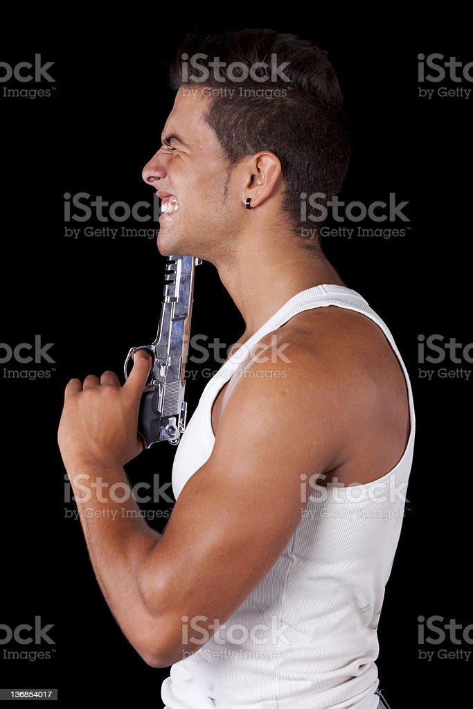 Man aiming a handgun at his head royalty-free stock photo