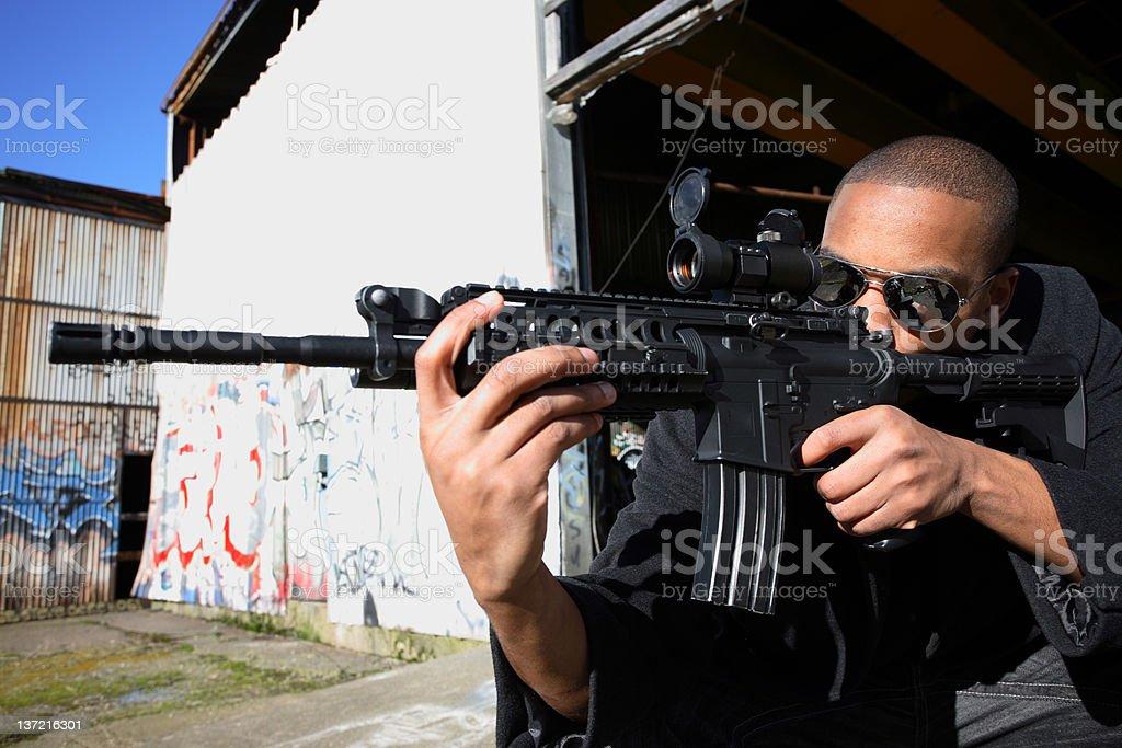 Man aiming a rifle royalty-free stock photo