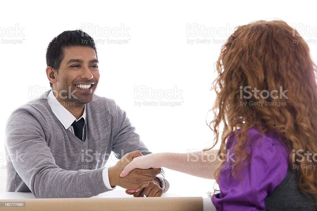 Man & Woman Working Together - Shaking Hands royalty-free stock photo