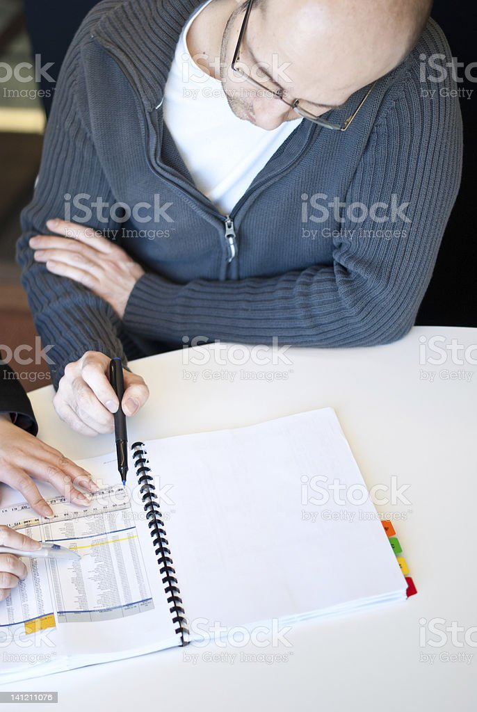 Man Analyzing a Report royalty-free stock photo