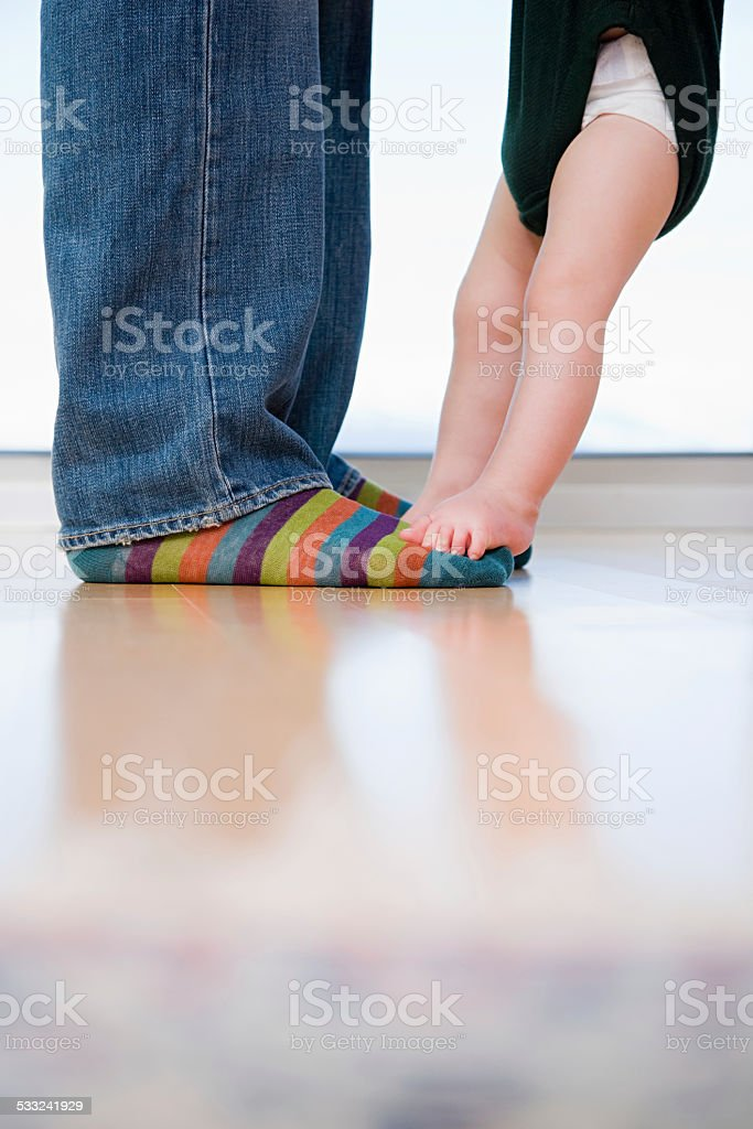 man and a babys feet stock photo
