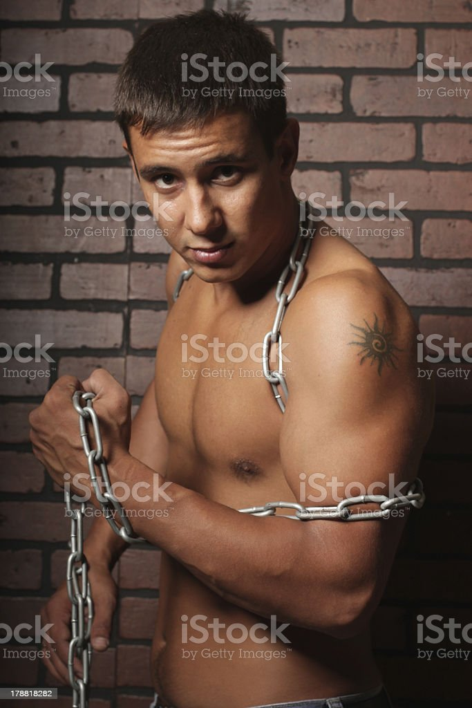 man and a chain. royalty-free stock photo