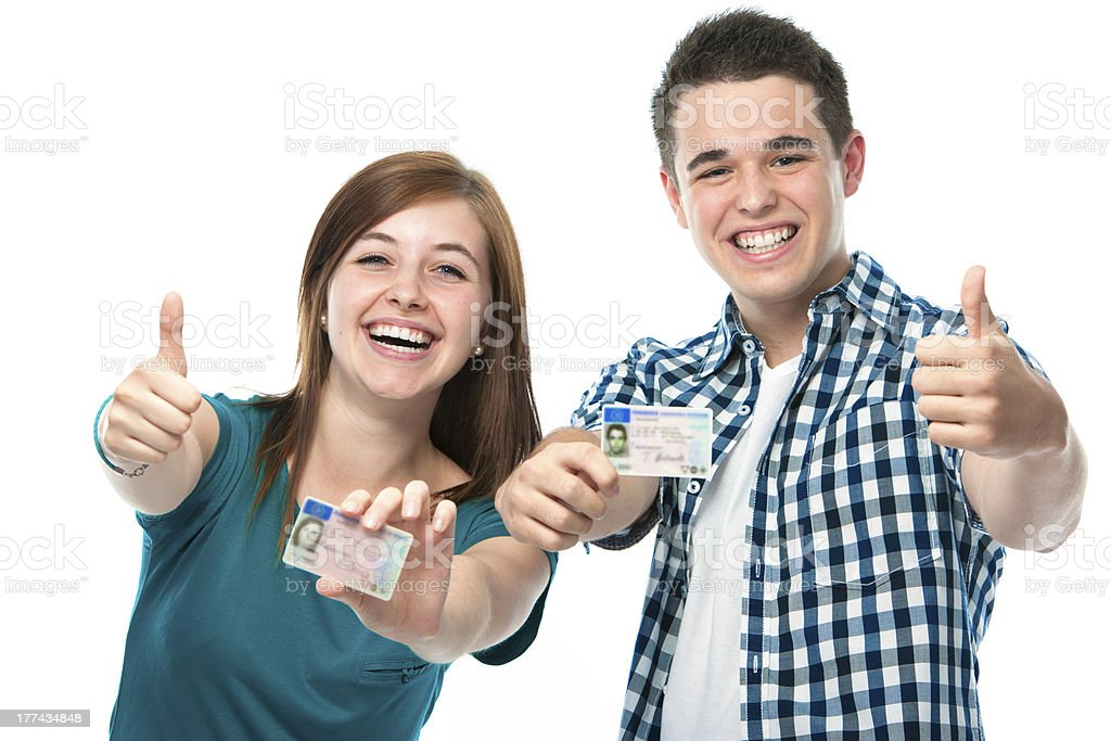A man and a woman holding up their drivers license stock photo