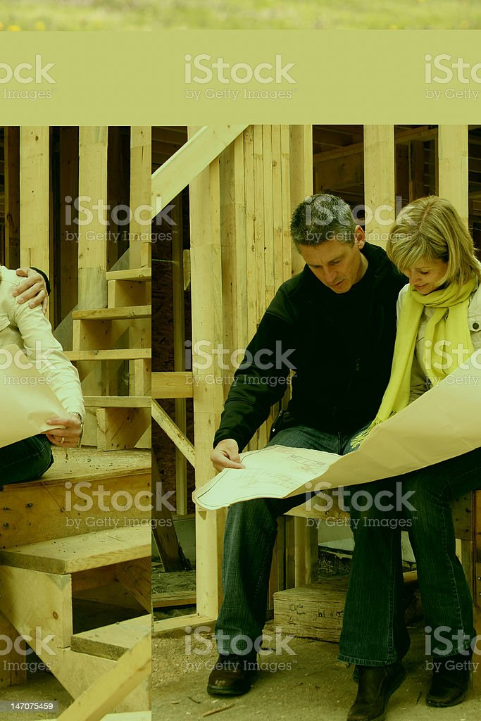 A man and a woman looking at blueprints to build a house stock photo