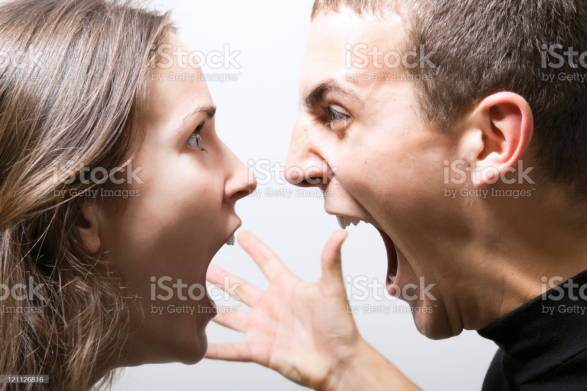 A man and a woman screaming at each other royalty-free stock photo