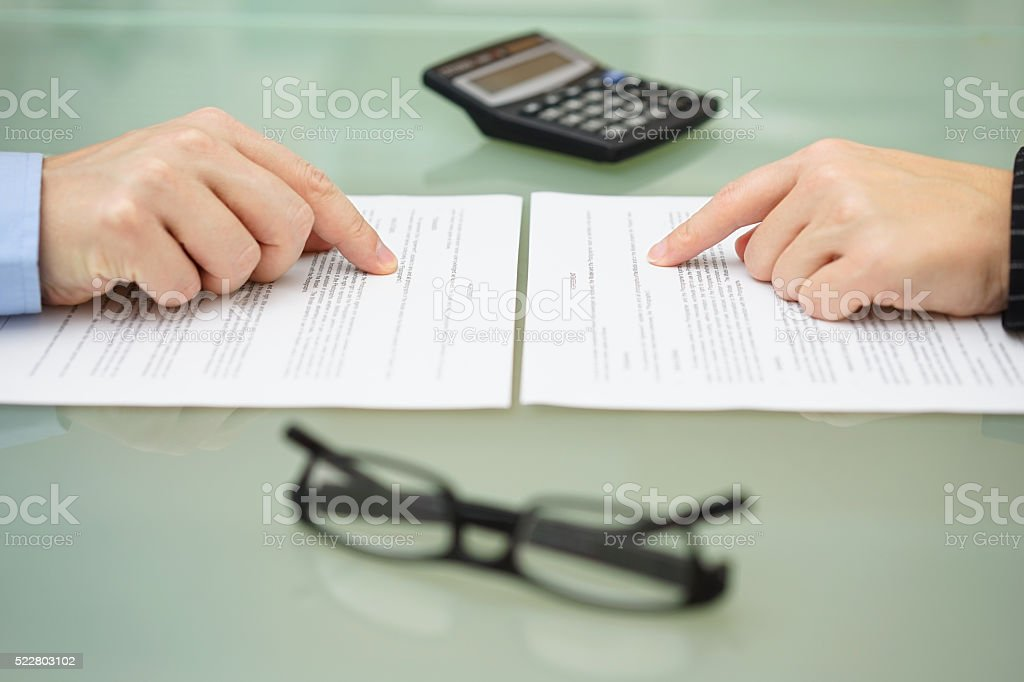 man and and woman are reading slowly insurance policy stock photo