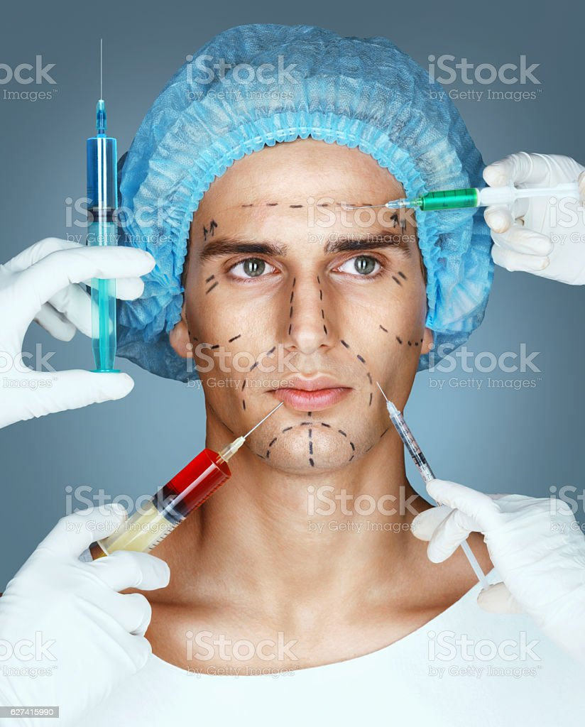 Man and Beautician Hands with Syringes stock photo