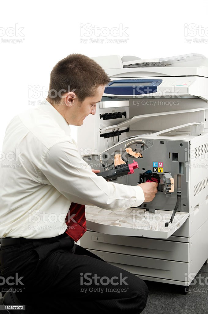 Man and big laser printer, isolated on white royalty-free stock photo