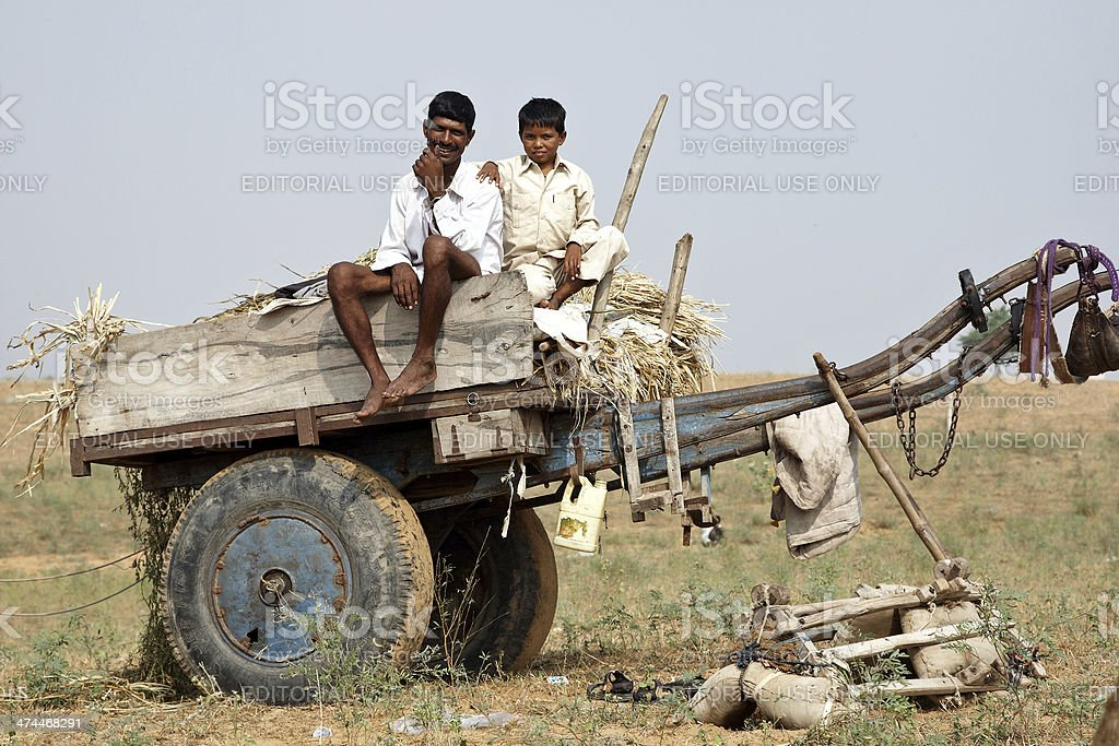 Man and boy on camel cart  at Pushkar Fair royalty-free stock photo