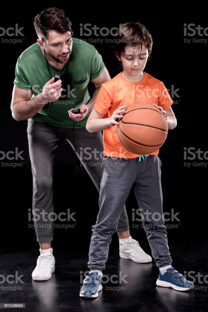man and boy training together stock photo