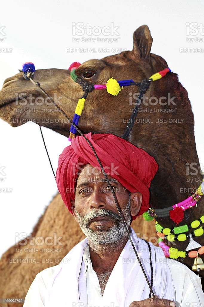 Man and Camel at Pushkar fair royalty-free stock photo