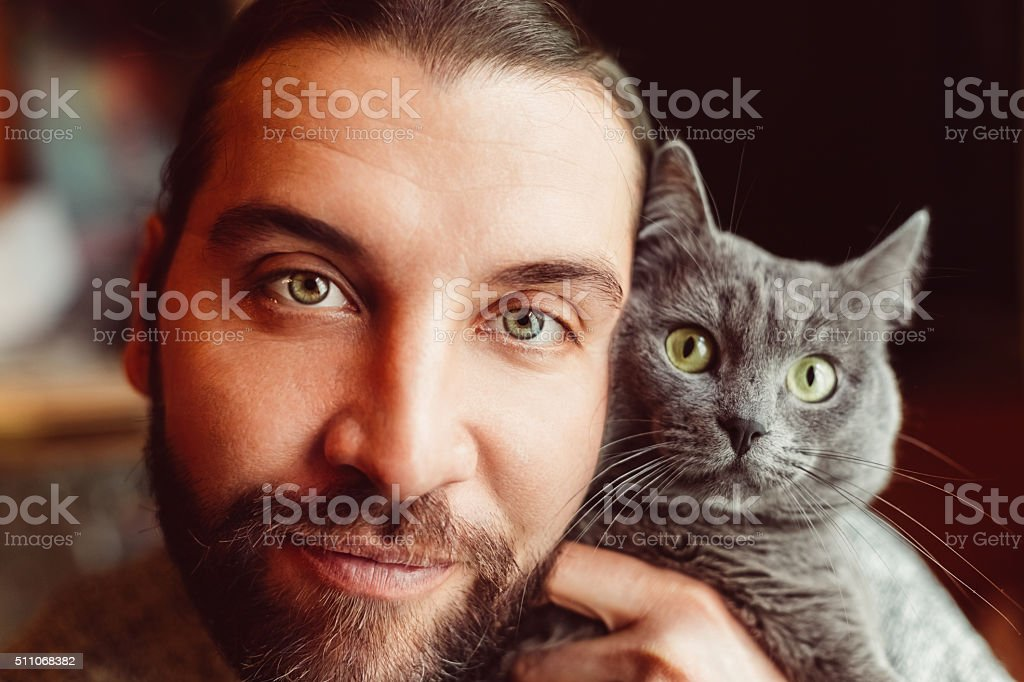 Portrait of man and cat stock photo