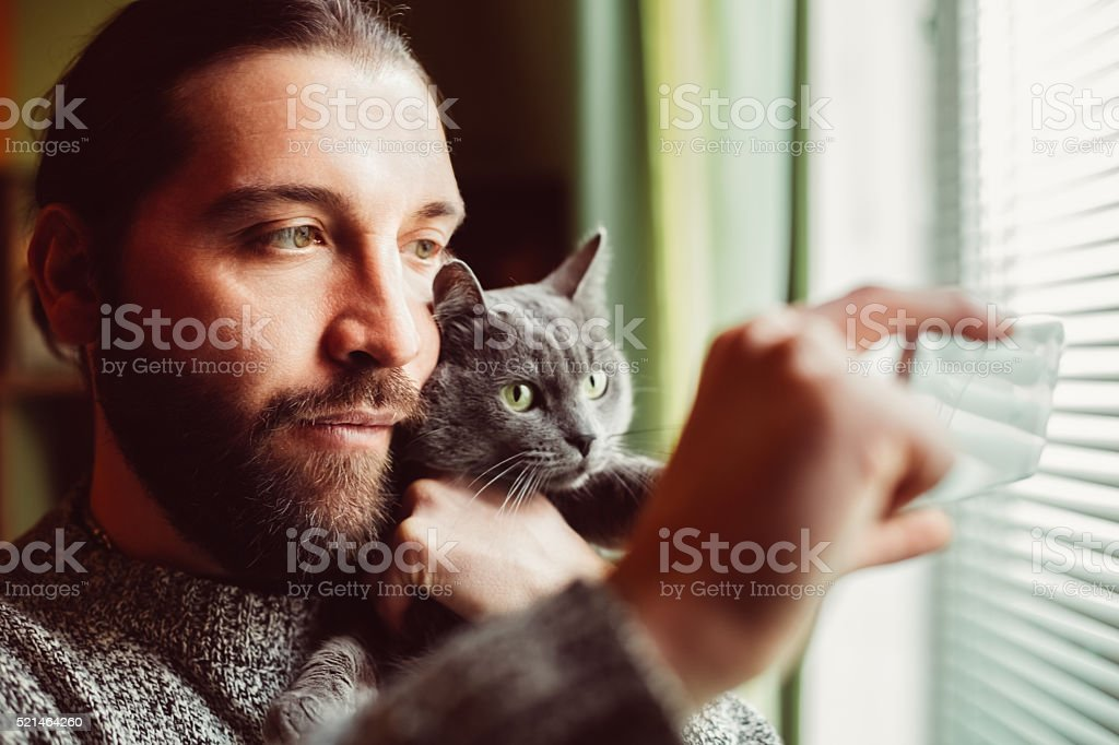 Man and cat taking selfie stock photo