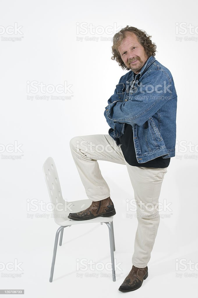 man and chair stock photo