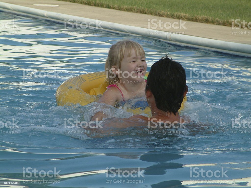 Man and Child in Pool stock photo