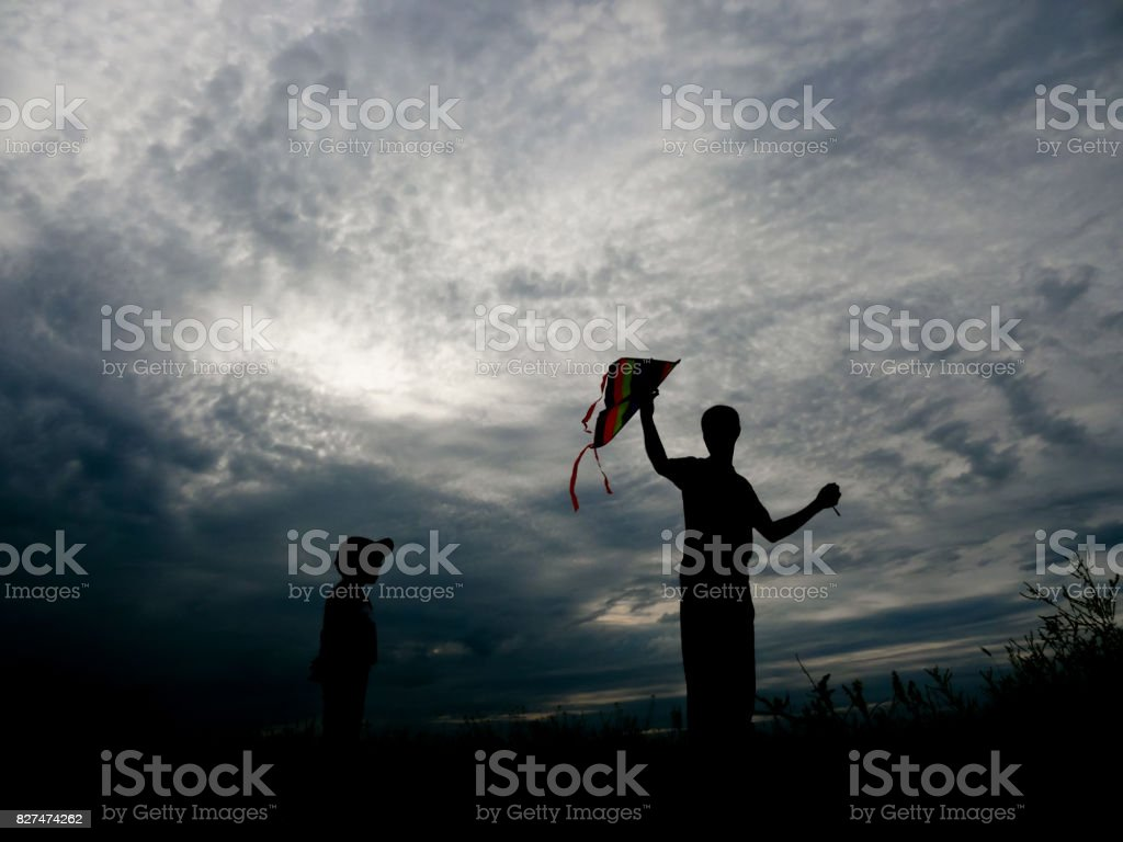 Man and child launch a kite into the air stock photo