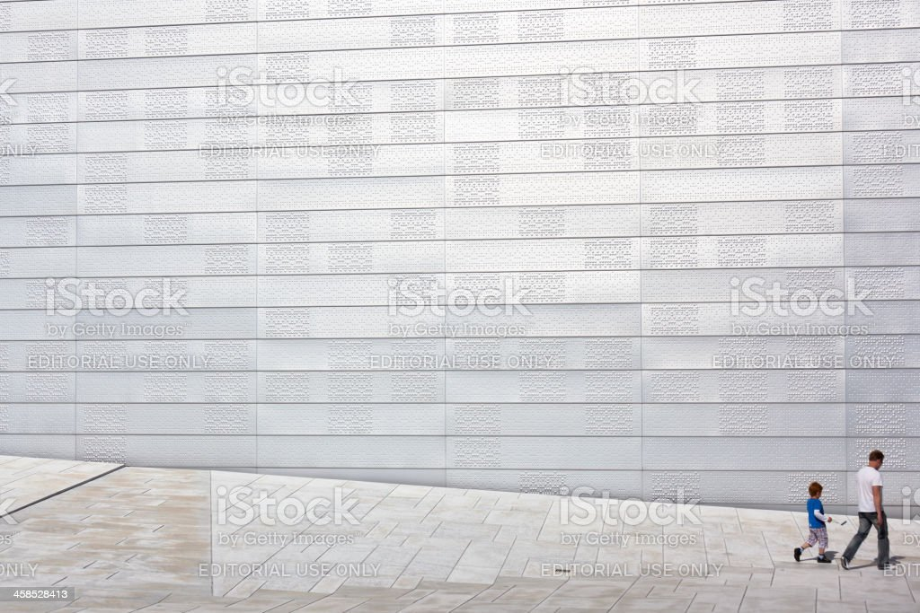 Man and child walk at Opera House in Oslo, Norway royalty-free stock photo