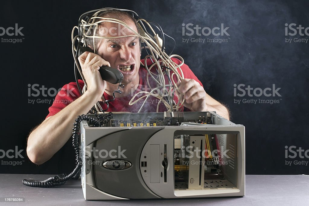 man and computer burning stock photo