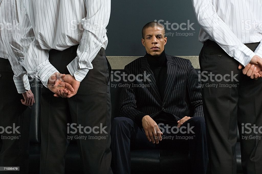 Man and employees stock photo