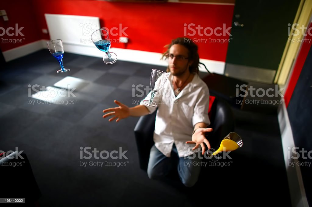Man and floating glasses stock photo
