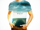 Man and flying plane in sky