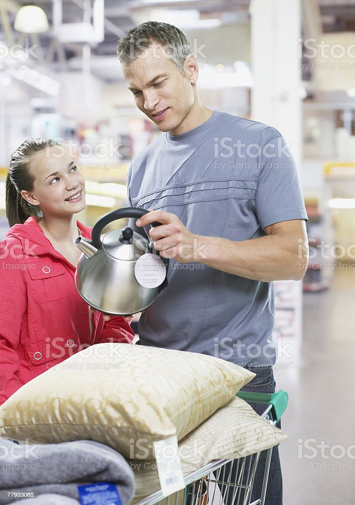Man and girl shopping for home supplies royalty-free stock photo
