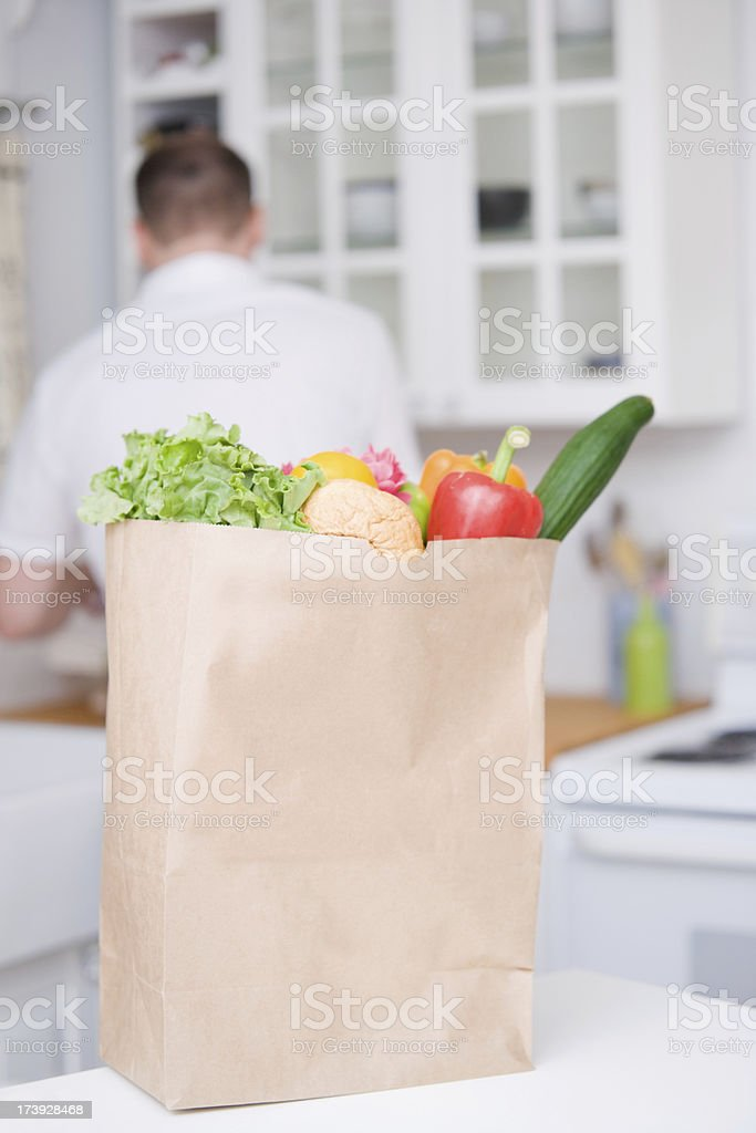 Man and Groceries in the Kitchen royalty-free stock photo