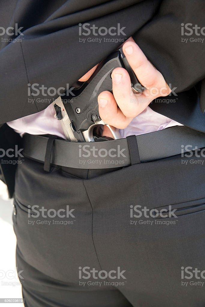 Man and  gun stock photo