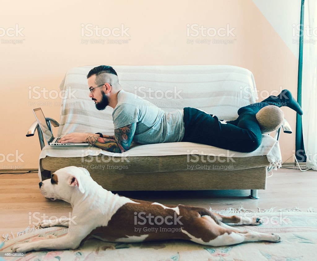 Man and his best friend dog at home. stock photo