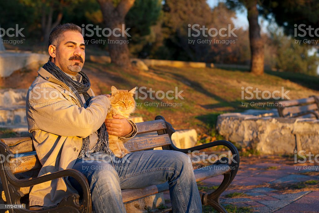 man and his cat royalty-free stock photo