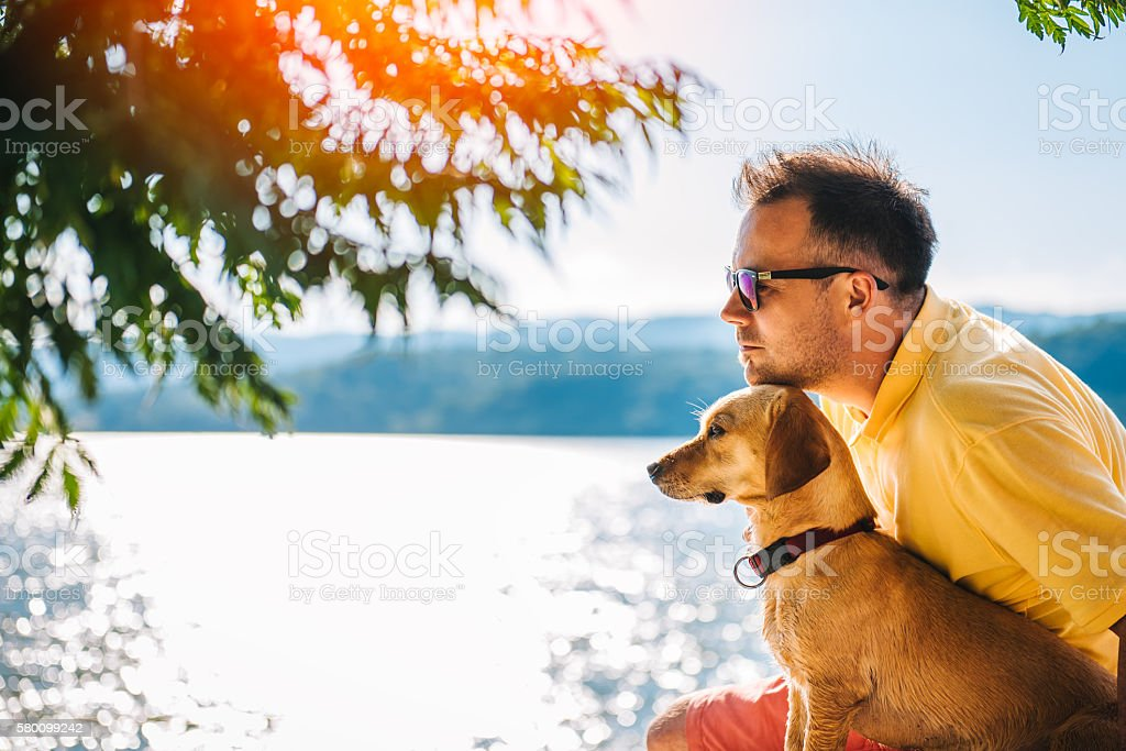 Man and his dog enjoying time together stock photo
