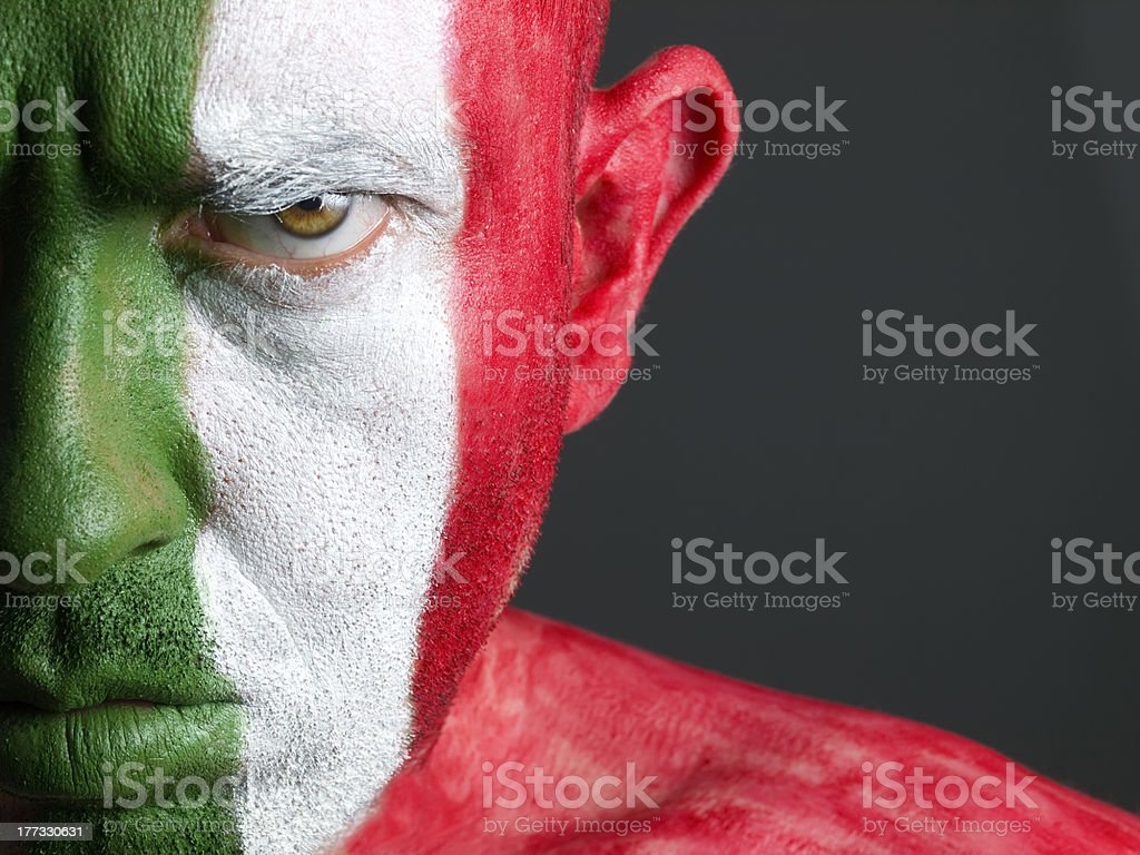 Man and his face painted with the flag of Italy stock photo