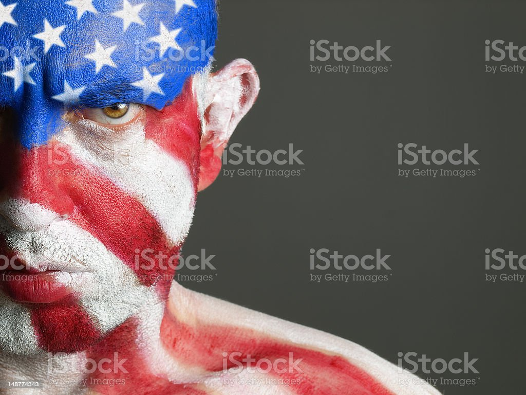 Man and his face painted with the flag of USA stock photo