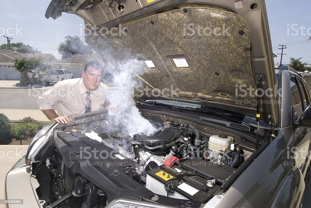 Man and his over heated car stock photo