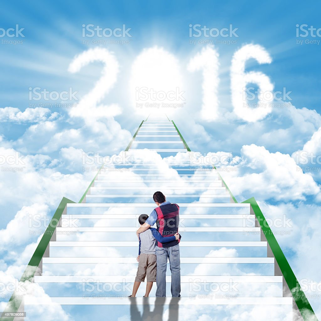 Man and his son on the stairs with numbers 2016 stock photo