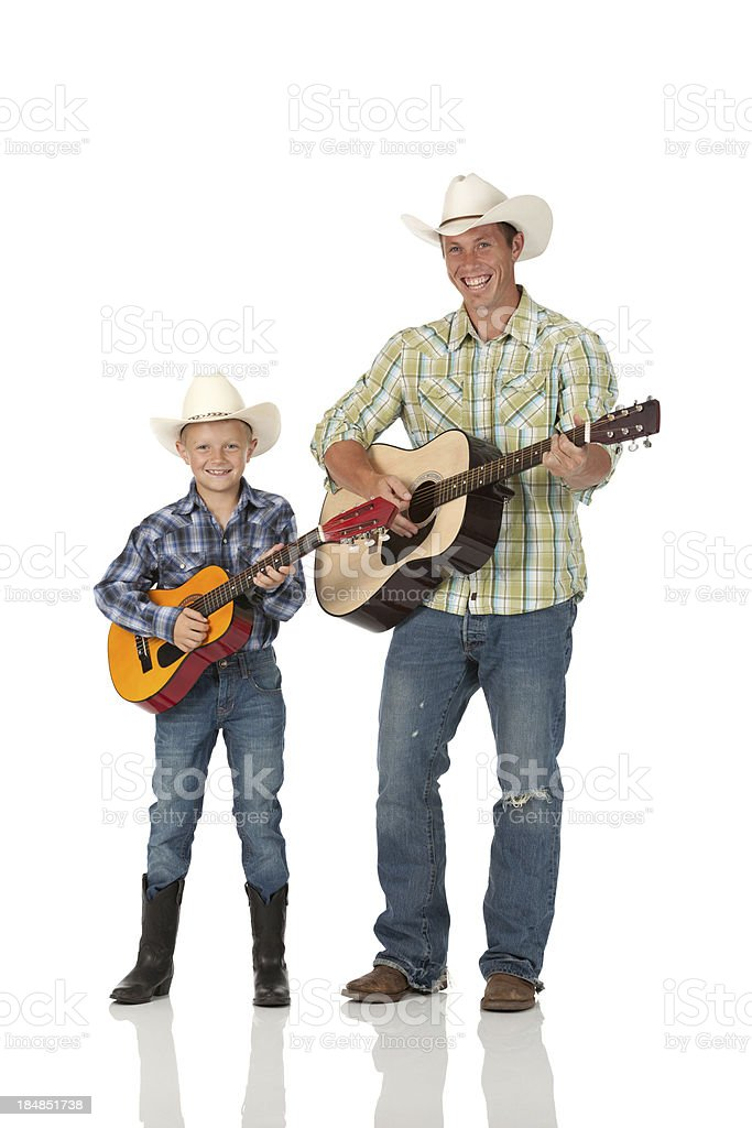 Man and his son playing guitars royalty-free stock photo