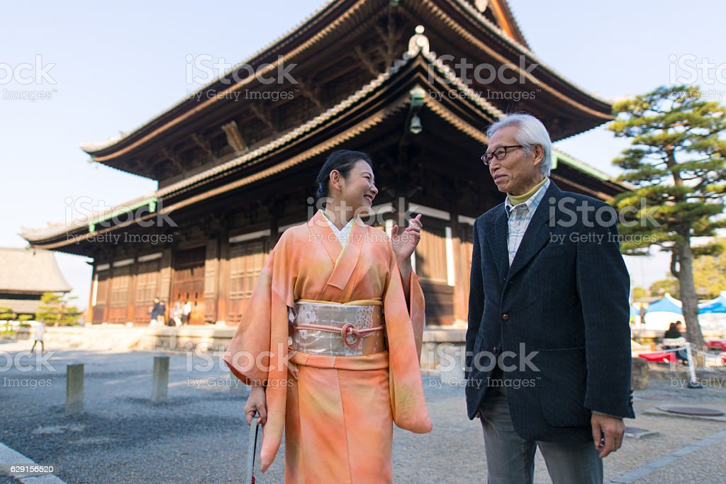 Man and Kimono woman talking in Tofukuji temple, Kyoto stock photo