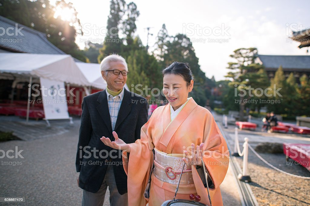 Man and Kimono woman walking together with smile stock photo