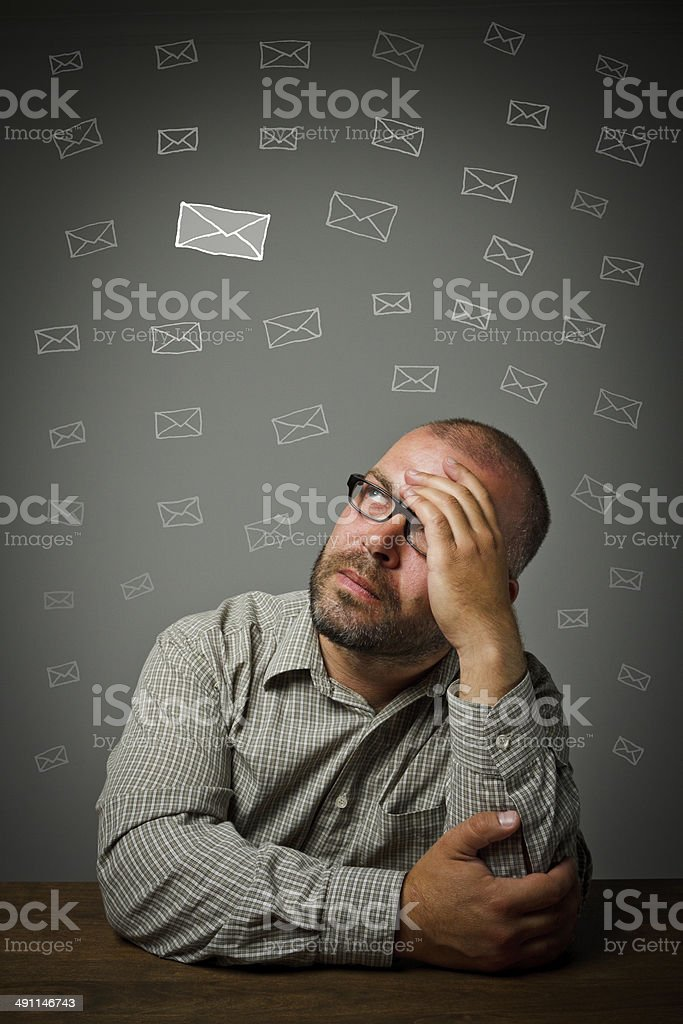 Man and letters. Thinking. stock photo