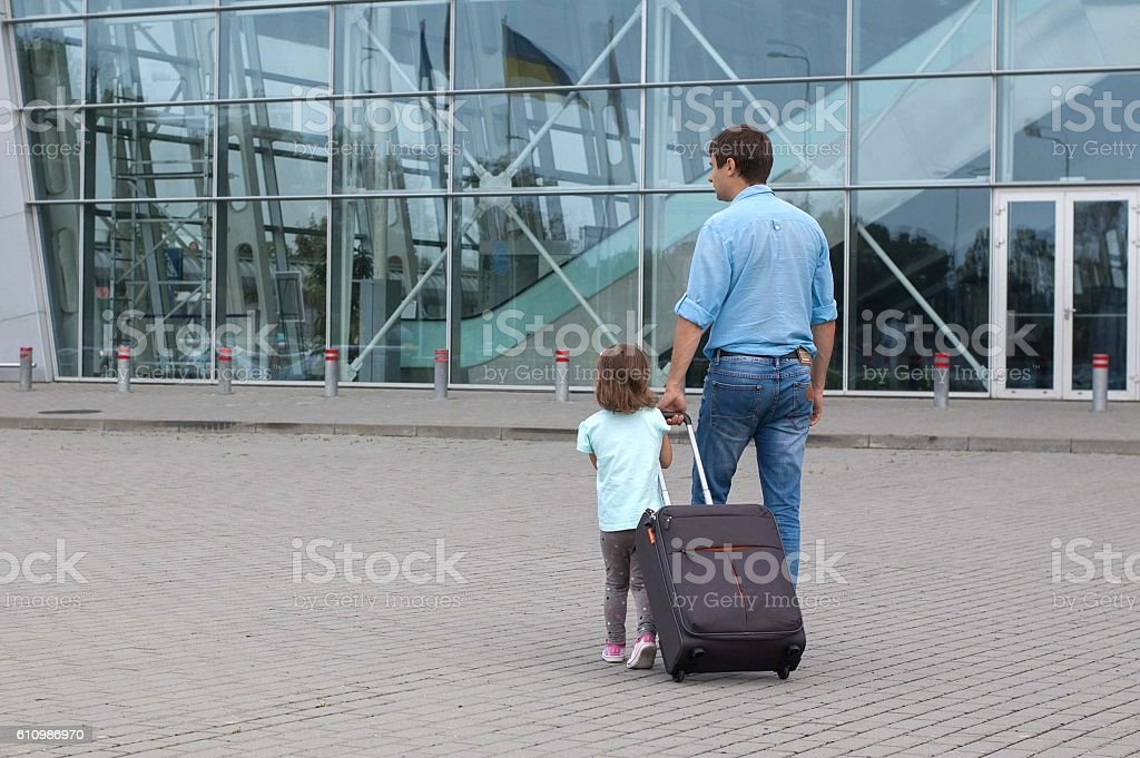 Man and little girl a going to the airplane. stock photo