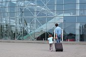 Man and little girl a going to the airplane.
